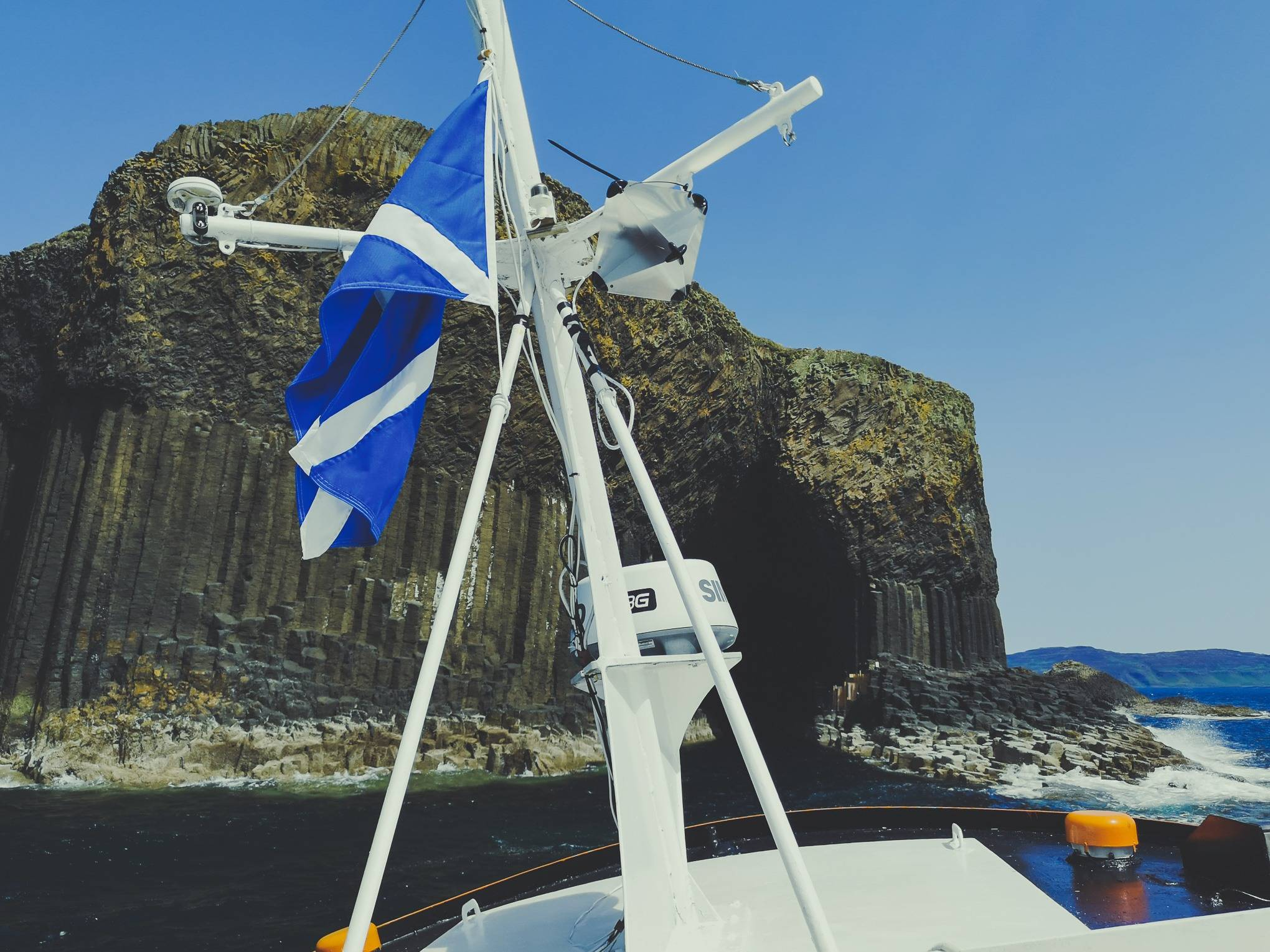 Boat approaching Fingal's Cave, Staffa Island, Hebrides, Scotland