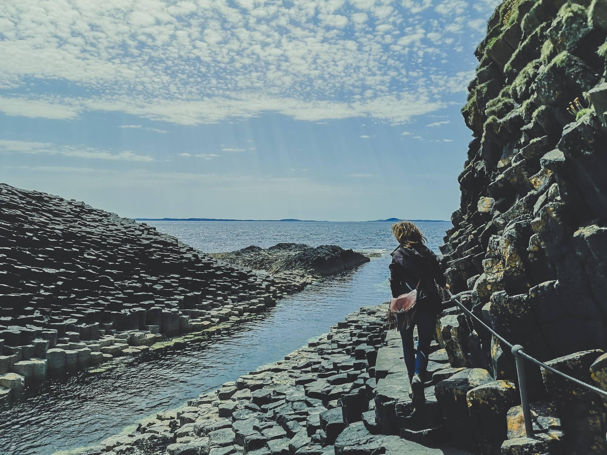 Walking toward FIngal's Cave, Staffa island, Hebrides, Scotland
