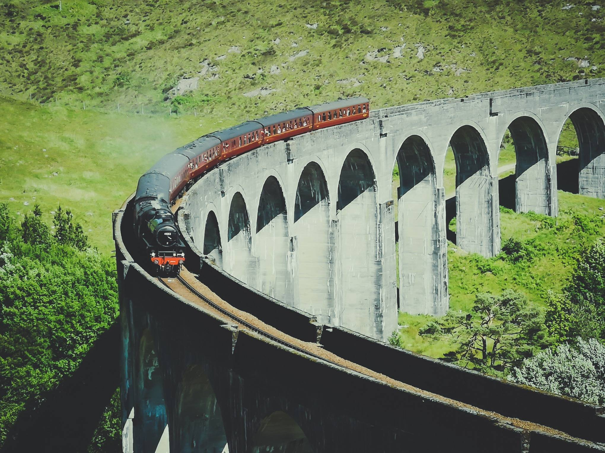 """The actual Harry POtter train """"The Jacobite"""" doesn't spit out as much of a steam as it does in the movie. Photo by Alis Monte [CC BY-SA 4.0], via Connecting the Dots"""