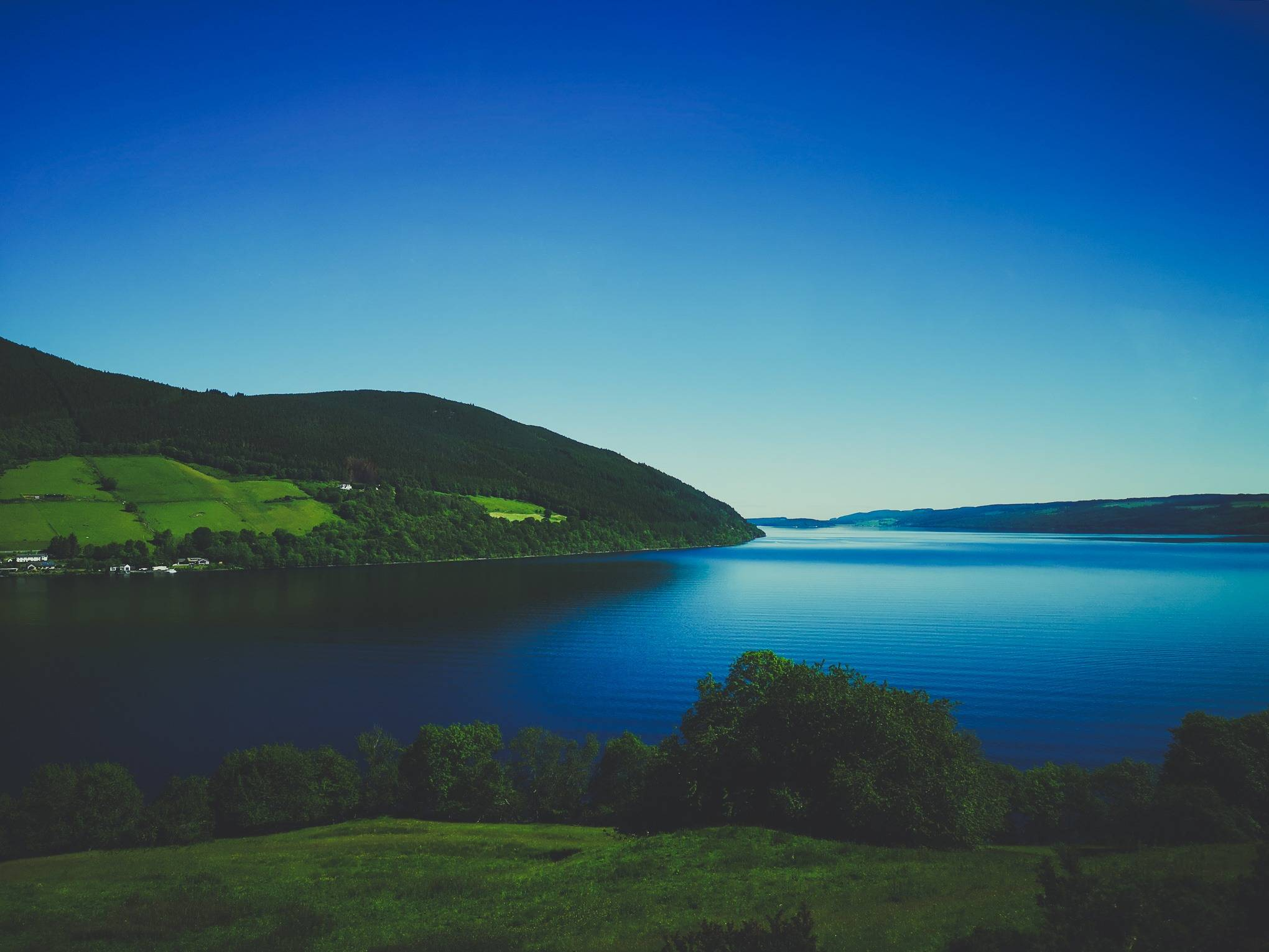 Loch Ness surounded by hills on a sunny day, Highlands of Scotland. Photo by Alis Monte [CC BY-SA 4.0], via Connecting the Dots