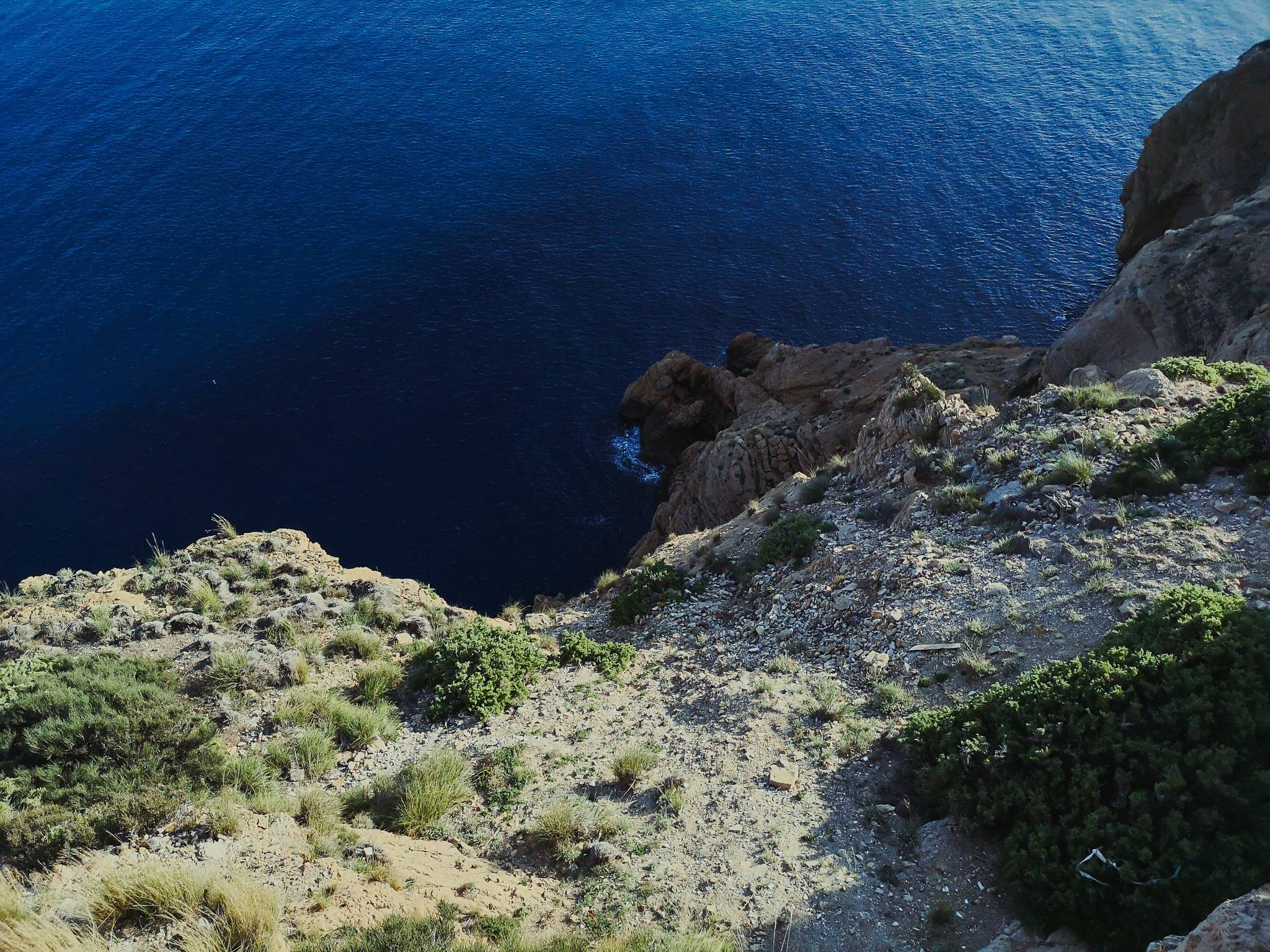 At the point, where Albir lighthouse was built, the height of the cliff facing the sea is about 112m. Photo by Alis Monte [CC BY-SA 4.0], via Connecting the Dots
