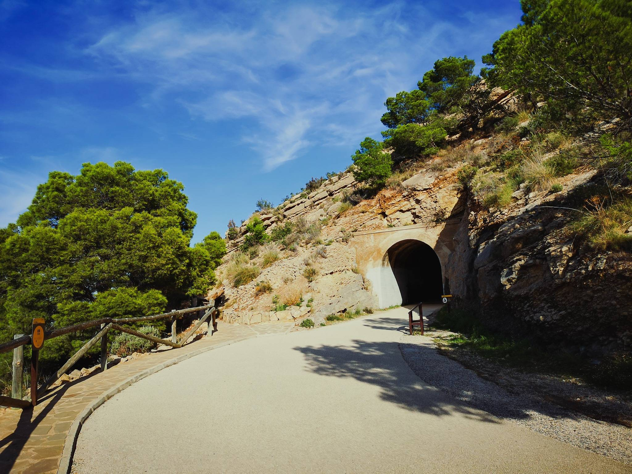 The next thing to catch your attention, undoubtedly, is going to be a tunnel, built here 60 years ago to make the access to 156-year old Albir lighthouse less dangerous. Photo by Alis Monte [CC BY-SA 4.0], via Connecting the Dots