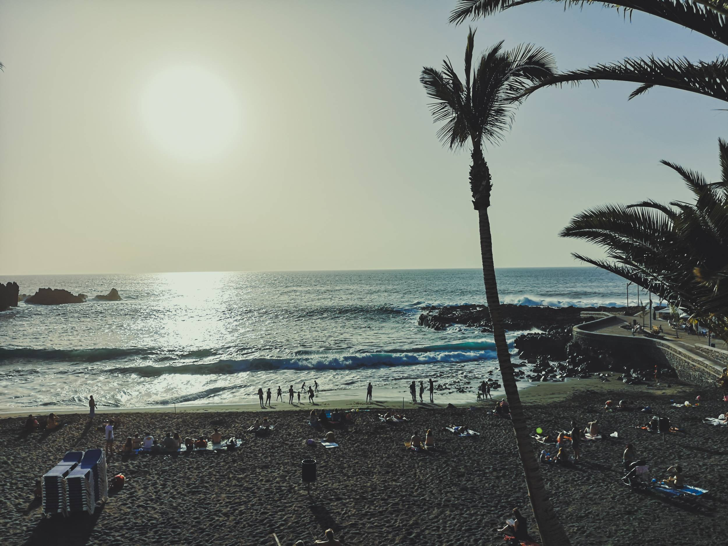 Most of the beaches in Tenerife has its sand colored black by Teide volcano. Photo by Alis Monte [CC BY-SA 4.0], via Connecting the Dots